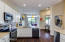 Kitchen opens to Family Rm & Nook letting in the natural light from 8 foot windows.
