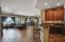 """View from front door of great room and wet bar- notice 18"""" designer tile flooring"""