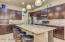 Kitchen with professionally refinished cabinetry and new appliances