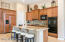 Gourmet Kitchen! with Slab Granite Counters and Island