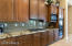 Stylish Backsplash, Granite Counter and Gas Cootop