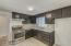 Kitchen with Gas Range, Refinished Cabinets, and Granite Counter Tops