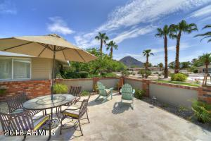 This beautifully clean and meticulously maintained home is located in a desirable Arcadia neighborhood, in the heart of the Camelback Corridor! The 4 bedroom, 3 bathroom home also features an office/den and is situated on a large cul-de-sac lot that offers stunning views of Camelback Mountain. In addition to the circular driveway, you'll find a three-car garage with one extended bay for over-sized vehicle. Inside of the remodeled ranch-style home, you'll find a floor plan that is ideal for family and offers a private guest wing. A few of the many recent upgrades include all appliances, new HVAC units, fresh carpet, and solid oak hardwood flooring. The South-facing backyard oasis features a beautiful lagoon pool and water feature, built-in gas grill, pool ramada, fire pit, RV gate, and a large grassy area that offers the perfect space for a trampoline, swing set, or playing catch with the football (Ask to see approved plans for pool/exercise house in the backyard). This exquisite home is located near some of the best hiking, dining, shopping, and entertainment around! *Please note, owner is a license agent in the state of Arizona*