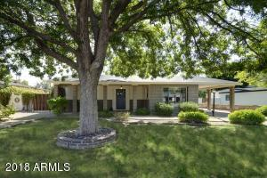 NEW PRICE! Welcome home to this quintessential Arcadia ranch-style charmer, complete with two living spaces, two dining spaces, and a bright and beautiful office space, in addition to three bedrooms. The gorgeous, open kitchen is equipped with white shaker cabinets, subway tile back splash, stainless steel appliances, honed granite counter tops, and a dry bar with wine fridge. Throughout the rest of the home, you'll find an endless list of designer finishes, including porcelain wood tile, plantation shutters, exposed brick fireplace, soft gray paint, granite counters, and carrera marble tile. The low maintenance backyard offers patio space, mature trees for shade, turf grass, and an air conditioned shed for Arizona Summer-proof storage.
