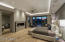 DuChateau wood flooring, Sub Zero mini fridge, separate sitting area, and private fireplace encased with Linac marble.