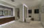 Walk-in shower and separate tub in master bathroom with his and her water closets and vanities.