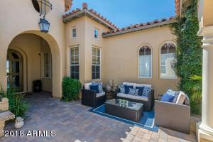 Courtyard entry has a beautiful Mediterranean rotunda, water feature and graceful archways lead to front door.