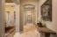 Arched doorways in hall leading to great room, dining and guest suites.