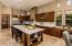 Tons of cabinetry, beautiful travertine stone floors and large kitchen island.