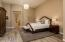 Master suite has a new chandelier and lovely porcelain wood-plank look flooring.