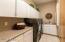 Large laundry room with counter space and sink.