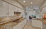 Very functional kitchen with a good amount of counter space, granite slab counters, custom stone backsplash and under counter lighting