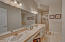 This is a large space, double sinks, sit down vanity, separate shower and soaking tub