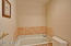 Downstairs updated stone finishes In Suite Bath has separate soaking tub and shower, very good sized room