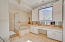 private toilet room, double sinks, separate shower and tub with whirlpool jets - large space