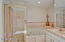 Separate Shower, Whirlpool Tub, double sink with sit down cosmetic vanity very light and bright