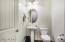 Powder room is convenient to great room, den and garage, yet off the hallway towards the laundry for modesty.