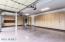 2 walls of custom cabinets, work area and epoxied floor.