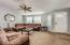 The spacious great room is bright and airy with large windows and high ceilings