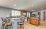 This Kitchen is huge and has recessed lighting in all the right places