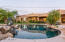Discover the custom designed, resort-style backyard that is incredibly lush and well-maintained with a heated pebble-tec pool and an elevated spa. The built-in misters and custom electronic awnings will keep you cool all summer long, featuring a great entertainment BBQ/outdoor kitchen area surrounded by a beautiful flagstone patio, gas fireplace with incredible city light views at night.