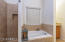 Soaking tub and walk in shower in master