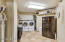 In the middle of it all is the laundry room with space for an extra refrigerator and/or freezer and plenty of storage space. It is located just down the hall from the master bedroom and bedrooms 2,3 & 4