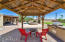 Covered gazebo at bbq area provides great shade for grilling and outside relaxing by a nice firepit with new pavestone flooring