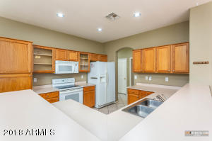 The kitchen is both spacious and bright. Built in microwave, upgraded cabinetry, dual Stainless steel sink, dishwasher, and lots of counter space accentuates this space. Refrigerator is included!