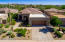 Excellent curb appeal, beautiful blooming landscape and huge Saguaro.