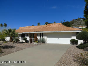 Wonderful home centrally located in the terrific Piestawa Peak area right off the 51. Very large lot with fabulous mountain views from the home and yard in several directions. Formal living room and dining room plus family room off kitchen and casual dining area adjacent to kitchen. Rock fireplace in family room which could be opened up for a great room feel. Tile in all the right places with carpet in the bedrooms. Fabulous storage in the home and garage. Huge covered patio and built-in barbeque, as well.