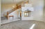 Spacious formal living area & grand staircase - new carpet...