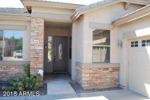 Covered front entry of this beautiful single level home in Chandler, AZ 85249