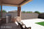 Built in BBQ, travertine pavers and synthetic grass.