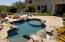 VIEW OF HEATED POOL AND FIRE PIT