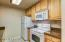 REMODELED KITCHEN WITH NATURAL MAPLE CABINETRY AND GRANITE COUNTERS