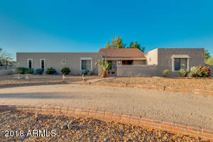 Lovely 1980's ranch style horse property in Glendale. More than 2/3's of an acre with horse facilities.