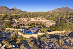 Nestled on over four acres of lush high sonoran desert...