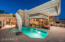 Pool with water feature and swim-up bar located in Great Room/Living Room