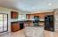 beautiful cabinets, granite counters, custom brick accents
