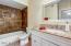 beautiful vanity w/ granite counter, tile tub surround