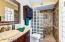 vanity w granite counter, custom shower w glass block