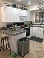 BEAUTIFUL GRANITE COUNTERTOPS AND NEWER APPLIANCES
