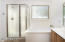 Master bathroom with large tub, separate walk-in shower