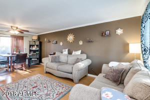 Spacious family room with crown molding open to the dining room.