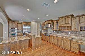 Kitchen with gorgeous upgraded granite and stainless appliances