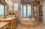 Gorgeous master bedroom sep shower and tub with stone