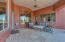 Covered patio with plenty of room for family and friends