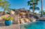 Relaxation sitting by the pool or swimming with the calming sound of the rock waterfall