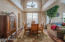 Dining room with vaulted ceilings and wood floors